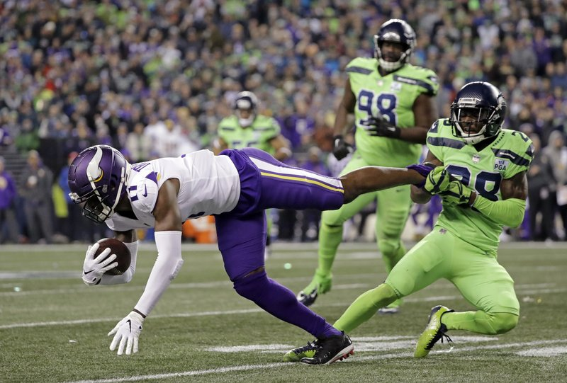 Seattle Seahawks' Justin Coleman, right, brings down Minnesota Vikings' Laquon Treadwell after a pass reception by Treadwell in the second half of an NFL football game, Monday, Dec. (AP Photo/Ted S. Warren)