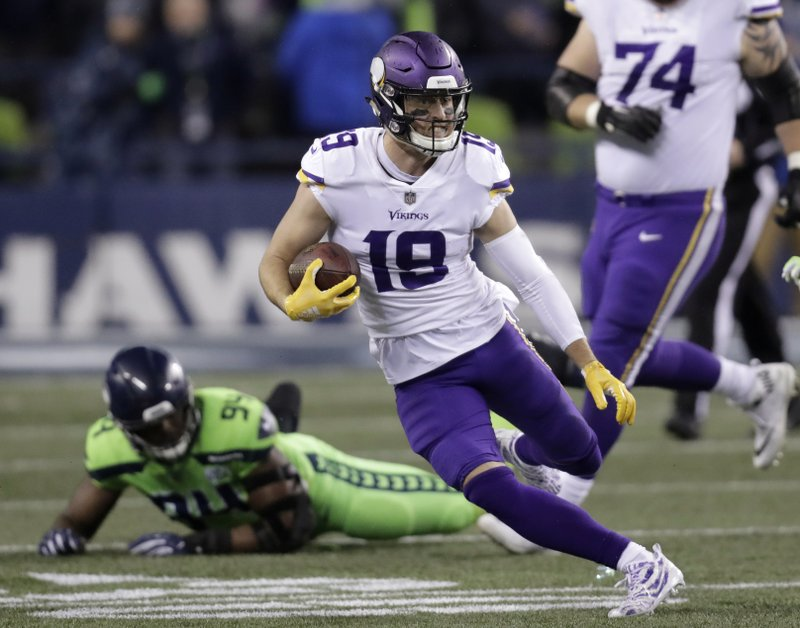 Minnesota Vikings' Adam Thielen runs with the ball after a reception against the Seattle Seahawks in the second half of an NFL football game, Monday, Dec. (AP Photo/Stephen Brashear)