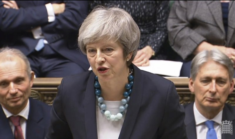 In this grab taken from video, Britain's Prime Minister Theresa May makes a statement in the House of Commons, in London, Monday, Dec. (PA via AP)