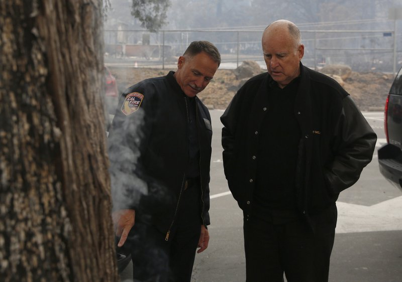 File - In this Nov. 14, 2018, file photo, Ken Pimlott, director of the California Department of Forestry and Fire Protection, left, shows California Gov. (AP Photo/Rich Pedroncelli, File)