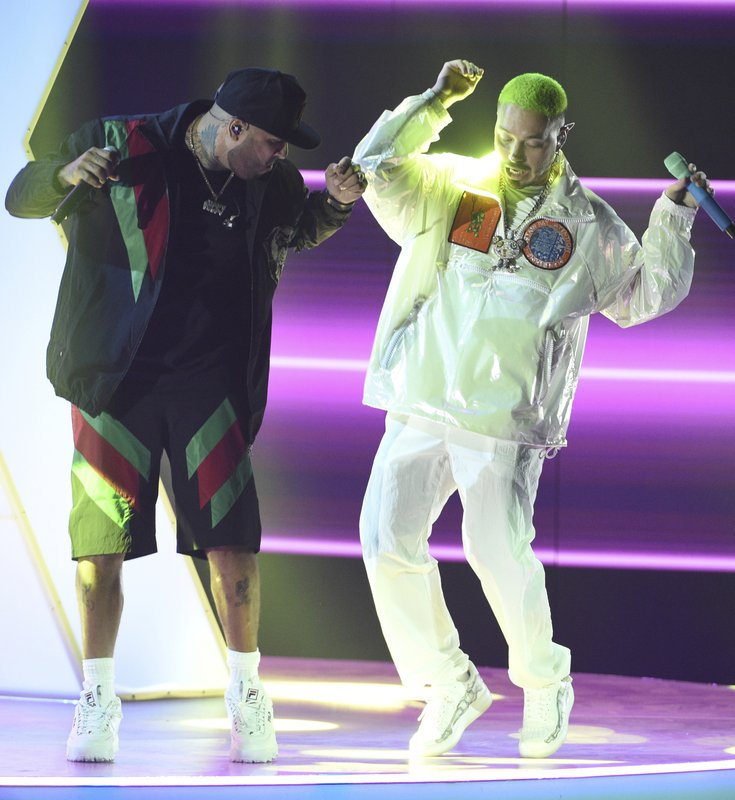 FILE - In this Nov. 15, 2018 file photo, Nicky Jam, left, and J Balvin perform at the Latin Grammy Awards in Las Vegas. (Photo by Chris Pizzello/Invision/AP)