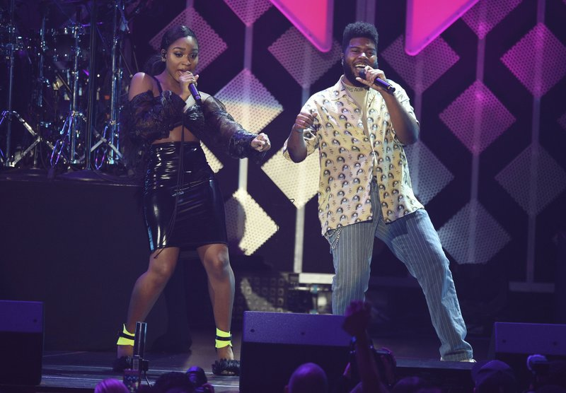 FILE - In this Nov. 30, 2018 file photo, Normani, left, and Khalid perform at Jingle Ball in Inglewood, Calif. (Photo by Chris Pizzello/Invision/AP)