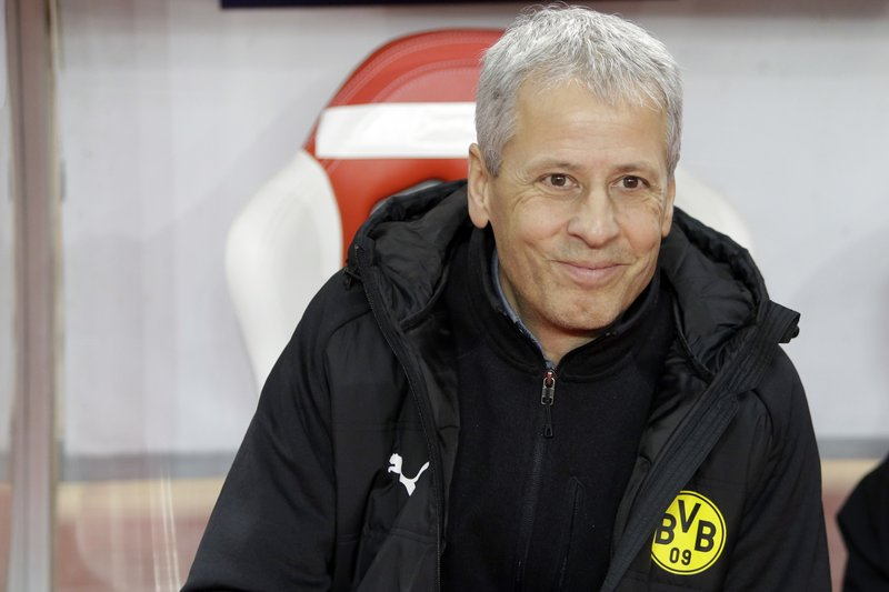 Dortmund's head coach Lucien Favre looks on prior to the Champions League group A soccer match between AS Monaco and Borussia Dortmund, in Monaco, Tuesday, Dec. (AP Photo/Claude Paris)