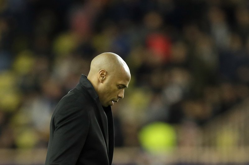 Monaco coach Thierry Henry walks out the pitch at half time during the Champions League group A soccer match between AS Monaco and Borussia Dortmund, in Monaco, Tuesday, Dec. (AP Photo/Claude Paris)