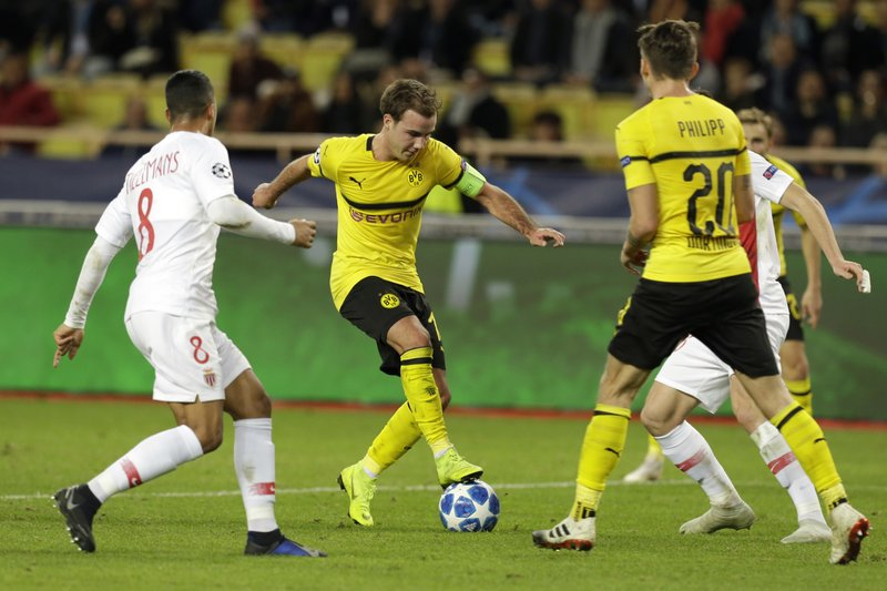 Dortmund's Mario Gotze, second right, controls the ball front of Monaco midfielder Youri Tielemans, left, during the Champions League group A soccer match between AS Monaco and Borussia Dortmund, in Monaco, Tuesday, Dec. (AP Photo/Claude Paris)