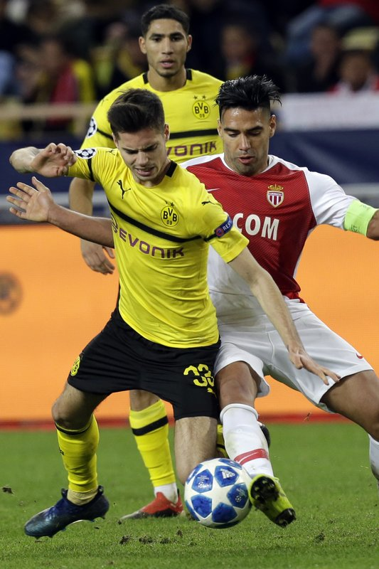 Dortmund's Julian Weigl, left, fights for the ball with Monaco forwarder Radamel Falcao during the Champions League group A soccer match between AS Monaco and Borussia Dortmund, in Monaco, Tuesday, Dec. (AP Photo/Claude Paris)