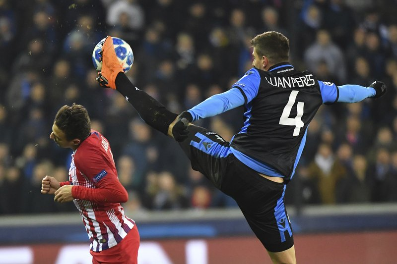 Brugge defender Luan Peres, right, chalenges for the ball with Atletico defender Santiago Arias during their Champions League group A soccer match between Club Brugge and Atletico Madrid at the Jan Breydel Stadium in Bruges, Belgium, Tuesday, Dec. (AP Photo/Geert Vanden Wijngaert)