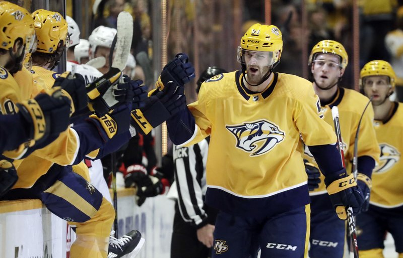 Nashville Predators left wing Austin Watson (51) is congratulated after scoring a goal against the Ottawa Senators in the first period of an NHL hockey game Tuesday, Dec. (AP Photo/Mark Humphrey)