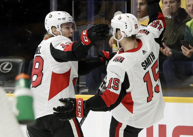 Ottawa Senators left wing Zack Smith (15) celebrates with Ryan Dzingel (18) after Smith scored a goal against the Nashville Predators in the first period of an NHL hockey game Tuesday, Dec. (AP Photo/Mark Humphrey)