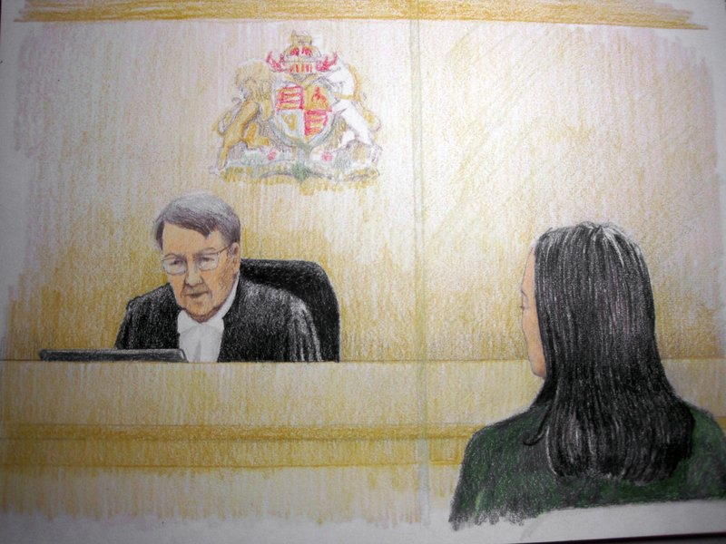 In this courtroom sketch, Meng Wanzhou, right, the chief financial officer of Huawei Technologies, listens to the judge during a bail hearing at B. (Jane Wolsak/The Canadian Press via AP)
