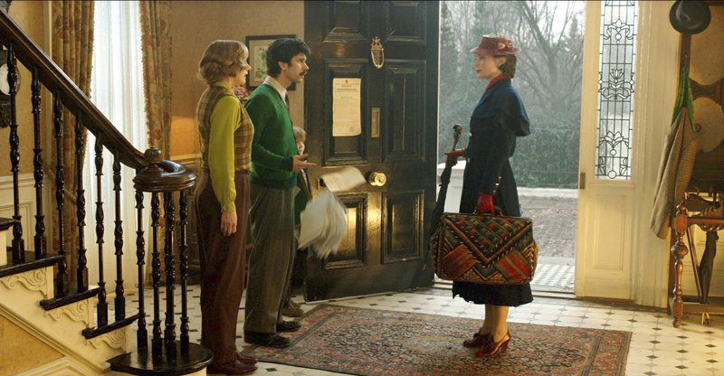 This image released by Disney shows Emily Mortimer, Ben Whishaw and Emily Blunt in