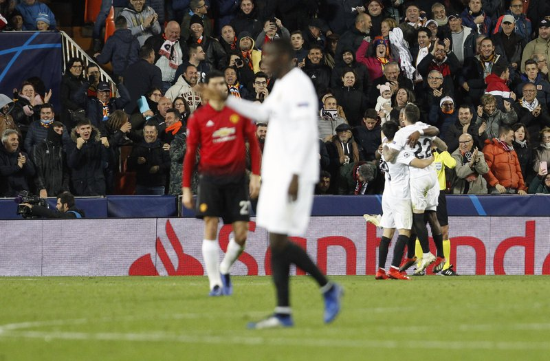 Valencia players celebrate after Manchester United's Phil Jones scores an own goal during a Group H Champions League soccer match between Valencia and Manchester United at the Mestalla Stadium in Valencia, Spain, Wednesday, Dec. (AP Photo/Alberto Saiz)