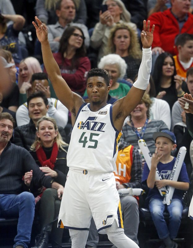 Utah Jazz guard Donovan Mitchell (45) celebrates after a teammate scored a 3-pointer against the Miami Heat in the second half during an NBA basketball game, Wednesday Dec. (AP Photo/Rick Bowmer)