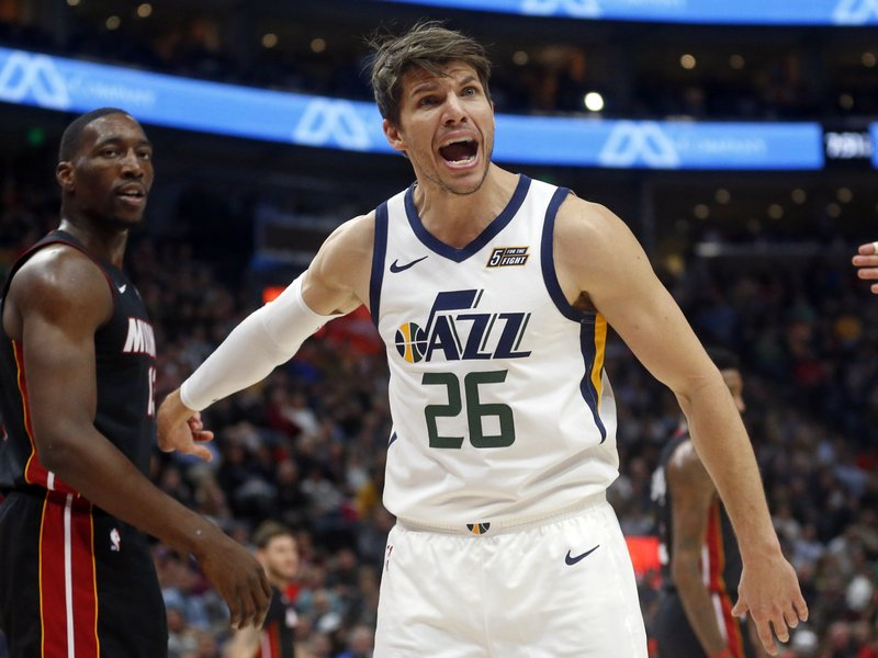 Utah Jazz guard Kyle Korver (26) shouts to an official as Miami Heat center Bam Adebayo, left, looks on in the first half of an NBA basketball game, Wednesday Dec. (AP Photo/Rick Bowmer)