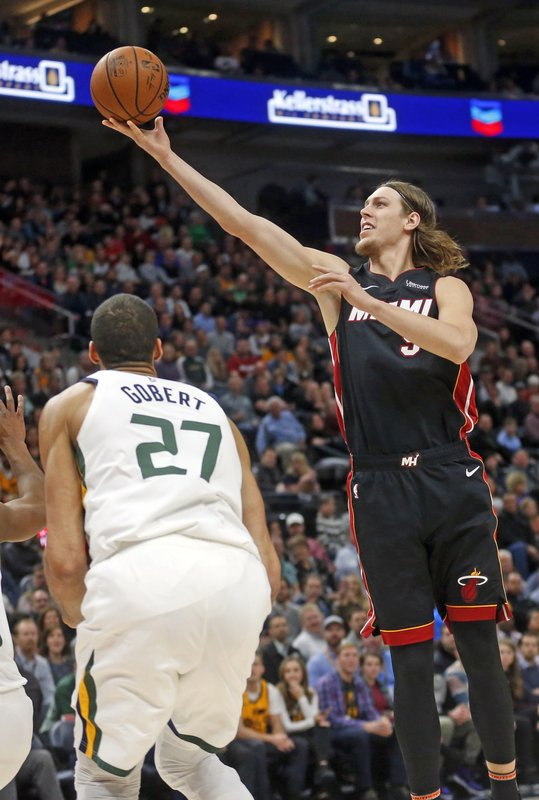 Miami Heat forward Kelly Olynyk, right, lays the ball up as Utah Jazz center Rudy Gobert (27) looks on in the first half during an NBA basketball game Wednesday Dec. (AP Photo/Rick Bowmer)