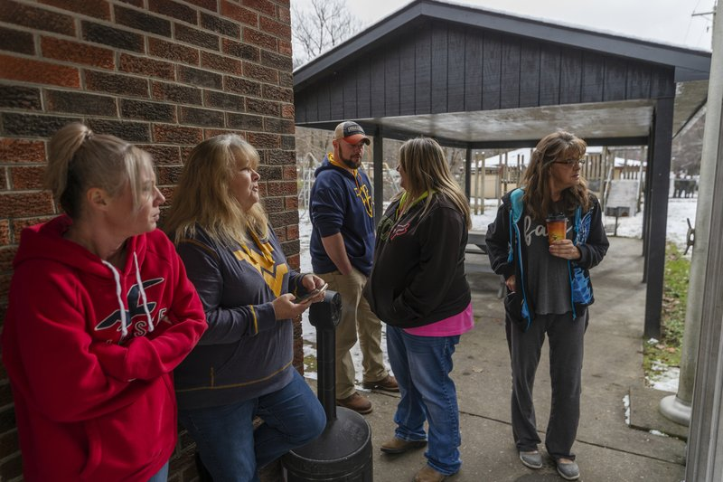 Family and friends await word of the search teams efforts in finding Cody Beverly, Kayla Williams and Erica Treadway at the Salamy Memorial Center in Whitesville, W. (Craig Hudson/The Charleston Gazette-Mail via AP)