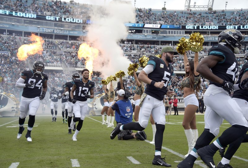 FILE - In this Sunday, Dec. 2, 2018, file photo, Jacksonville Jaguars quarterback Blake Bortles (5) and teammates run onto the field before an NFL football game against the Indianapolis Colts in Jacksonville, Fla. (AP Photo/Phelan M. Ebenhack, File)