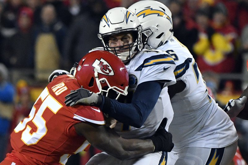 Los Angeles Chargers quarterback Philip Rivers is sacked by Kansas City Chiefs linebacker Dee Ford (55) during the first half of an NFL football game in Kansas City, Mo. (AP Photo/Ed Zurga)