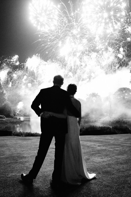 This photo released by Kensington Palace on Friday Dec. 14, 2018, shows the photo taken by Chris Allerton of Britain's Prince Harry and Meghan, Duchess of Sussex at their wedding reception at Frogmore House, Windsor, England, which is to be used as their 2018 Christmas card. (Chris Allerton/Kensington Palace via AP)