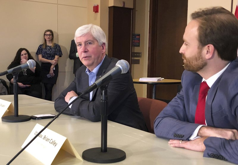 Michigan Gov. Rick Snyder, a Republican, speaks with reporters about his eight-year tenure and the Legislature's lame-duck session on Tuesday, Dec. (AP Photo/David Eggert)
