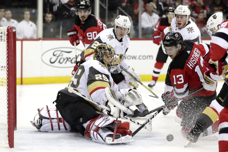 New Jersey Devils center Nico Hischier (13), of Switzerland, attacks as Vegas Golden Knights goaltender Marc-Andre Fleury (29) defends his net during the second period of an NHL hockey game, Friday, Dec. (AP Photo/Julio Cortez)