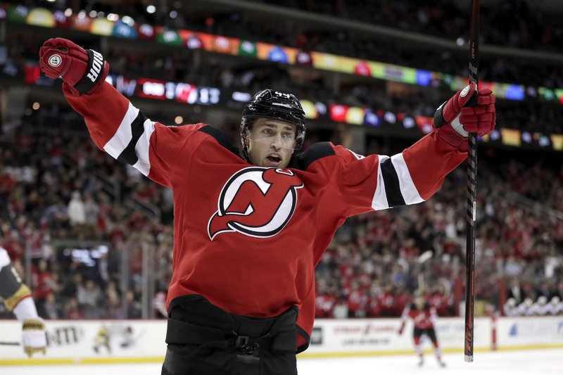 New Jersey Devils left wing Miles Wood reacts after scoring a goal against the Vegas Golden Knights during the second period of an NHL hockey game, Friday, Dec. (AP Photo/Julio Cortez)