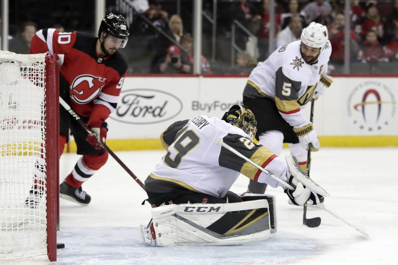 A shot by New Jersey Devils center Travis Zajac, not pictured, gets by Vegas Golden Knights goaltender Marc-Andre Fleury (29) for a goal during the second period of an NHL hockey game, Friday, Dec. (AP Photo/Julio Cortez)