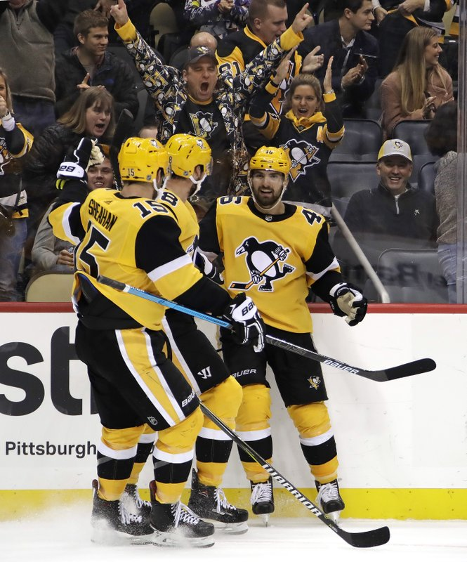 Pittsburgh Penguins' Zach Aston-Reese (46) celebrates his goal during the second period of an NHL hockey game against the Boston Bruins in Pittsburgh, Friday, Dec. (AP Photo/Gene J. Puskar)