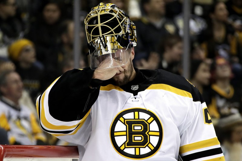 Boston Bruins goaltender Jaroslav Halak reacts after allowing a second-period goal to Pittsburgh Penguins' Zach Aston-Reese during an NHL hockey game in Pittsburgh, Friday, Dec. (AP Photo/Gene J. Puskar)