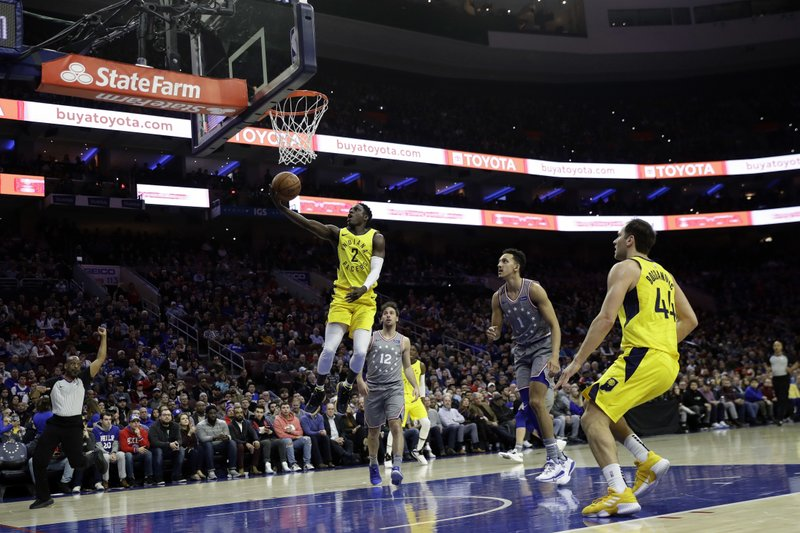 Indiana Pacers' Darren Collison (2) goes up to shoot after being fouled by Philadelphia 76ers' Landry Shamet (1) during the first half of an NBA basketball game, Friday, Dec. (AP Photo/Matt Slocum)