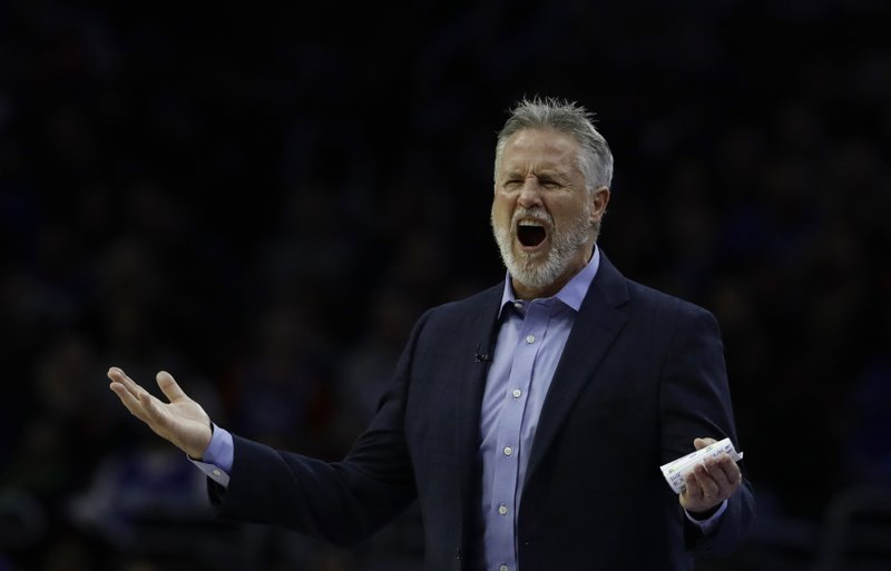 Philadelphia 76ers head coach Brett Brown reacts to a foul call during the first half of an NBA basketball game against the Indiana Pacers, Friday, Dec. (AP Photo/Matt Slocum)