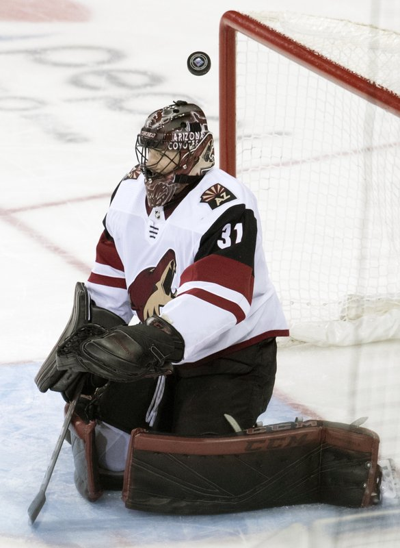 Arizona Coyotes goaltender Adin Hill makes a save during the third period of an NHL hockey game against the New York Rangers, Friday, Dec. (AP Photo/Mary Altaffer)