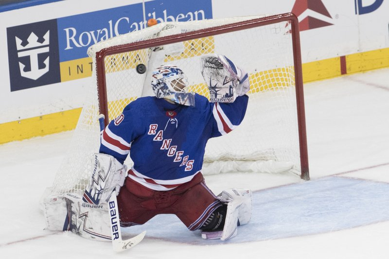 Arizona Coyotes defenseman Oliver Ekman-Larsson, not shown, scores a goal past New York Rangers goaltender Henrik Lundqvist to tied the game during the third period of an NHL hockey game, Friday, Dec. (AP Photo/Mary Altaffer)