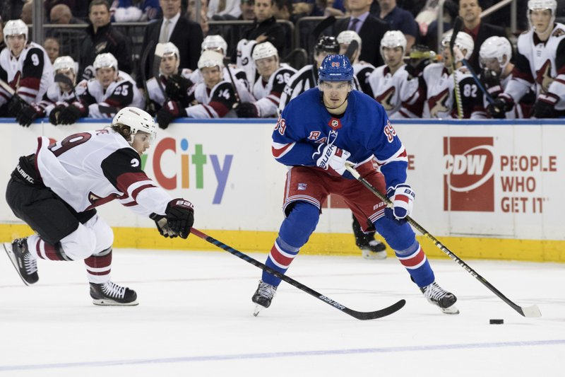 New York Rangers right wing Pavel Buchnevich (89) skates against Arizona Coyotes right wing Mario Kempe (29) during the second period of an NHL hockey game, Friday, Dec. (AP Photo/Mary Altaffer)