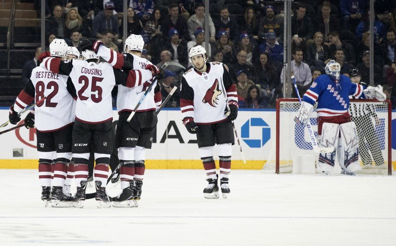 New York Rangers goaltender Henrik Lundqvist, right, reacts as Arizona Coyotes defenseman Jordan Oesterle (82) celebrates after scoring a goal during the second period of an NHL hockey game, Friday, Dec. (AP Photo/Mary Altaffer)