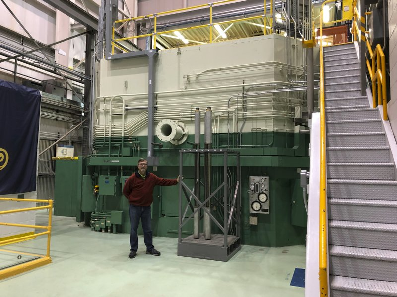 In this Nov. 29, 2018 photo, J.R. Biggs stands in front of the Transient Test Reactor he manages in Idaho Falls, Idaho. (AP Photo/Keith Riddler)