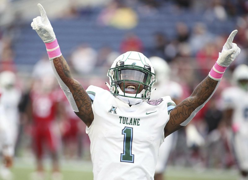 Tulane cornerback Donnie Lewis Jr. cheers after a play during the Cure Bowl NCAA college football game against Louisiana in Orlando, Fla, on Saturday, Dec. (Stephen M. Dowell/Orlando Sentinel via AP)