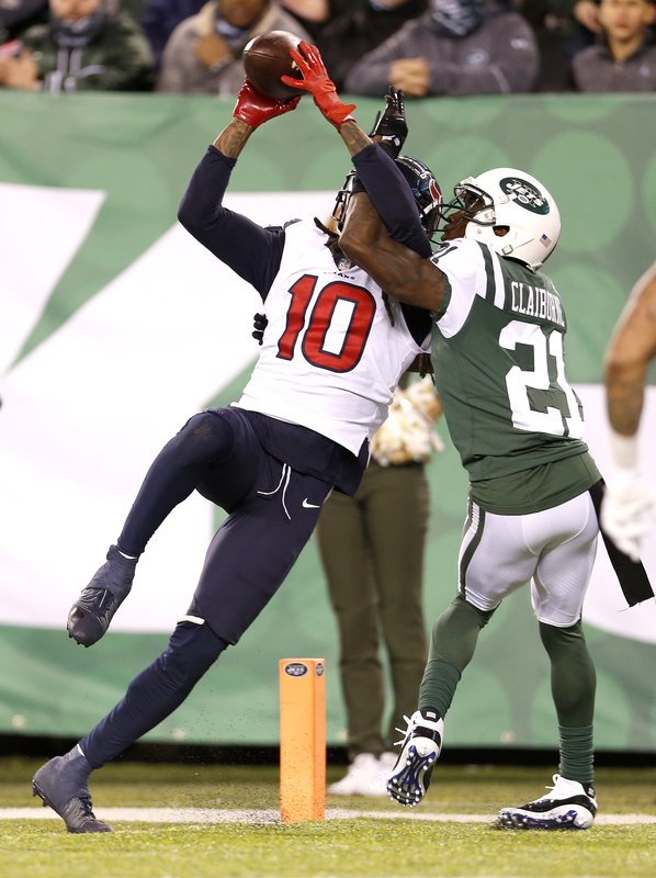 Houston Texans wide receiver DeAndre Hopkins (10) makes a touchdown catch on a pass from quarterback Deshaun Watson, not pictured, as New York Jets cornerback Morris Claiborne (21) defends during the second half of an NFL football game, Saturday, Dec. (AP Photo/Adam Hunger)