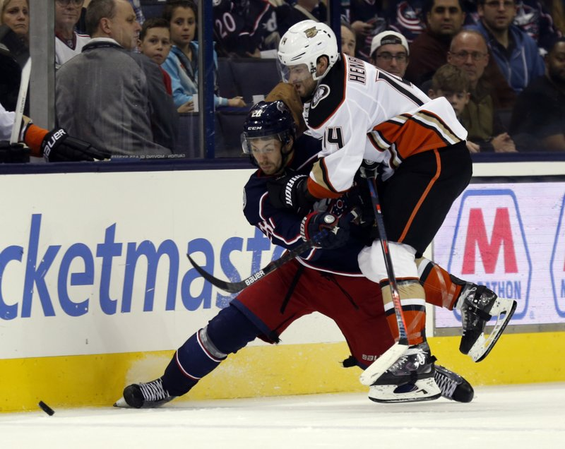 Anaheim Ducks forward Adam Henrique, right, collides with Columbus Blue Jackets forward Oliver Bjorkstrand, of Denmark, during the second period of an NHL hockey game in Columbus, Ohio, Saturday, Dec. (AP Photo/Paul Vernon)