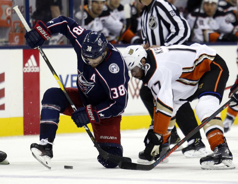 Columbus Blue Jackets forward Boone Jenner, left, works for the puck against Anaheim Ducks forward Ryan Kesler during the first period of an NHL hockey game in Columbus, Ohio, Saturday, Dec. (AP Photo/Paul Vernon)