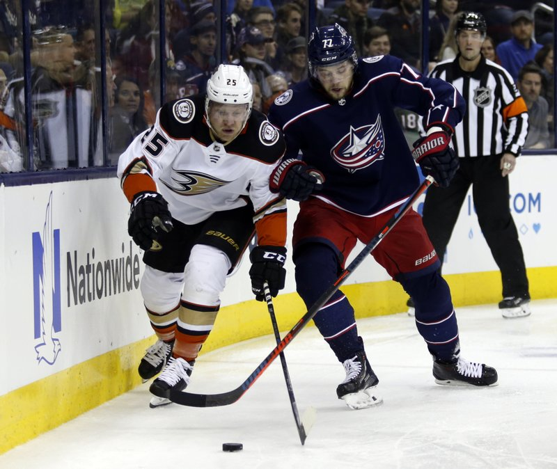 Anaheim Ducks forward Ondrej Kase, left, of the Czech Republic, and Columbus Blue Jackets forward Josh Anderson chase the puck during the second period of an NHL hockey game in Columbus, Ohio, Saturday, Dec. (AP Photo/Paul Vernon)