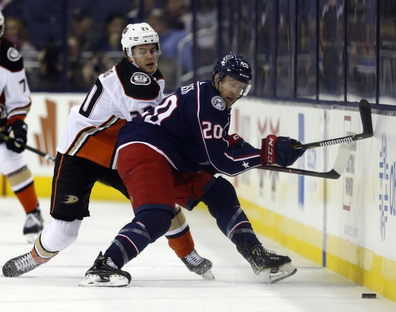 Columbus Blue Jackets forward Riley Nash, right, chases the puck against Anaheim Ducks forward Pontus Aberg, of Sweden, during the first period of an NHL hockey game in Columbus, Ohio, Saturday, Dec. (AP Photo/Paul Vernon)