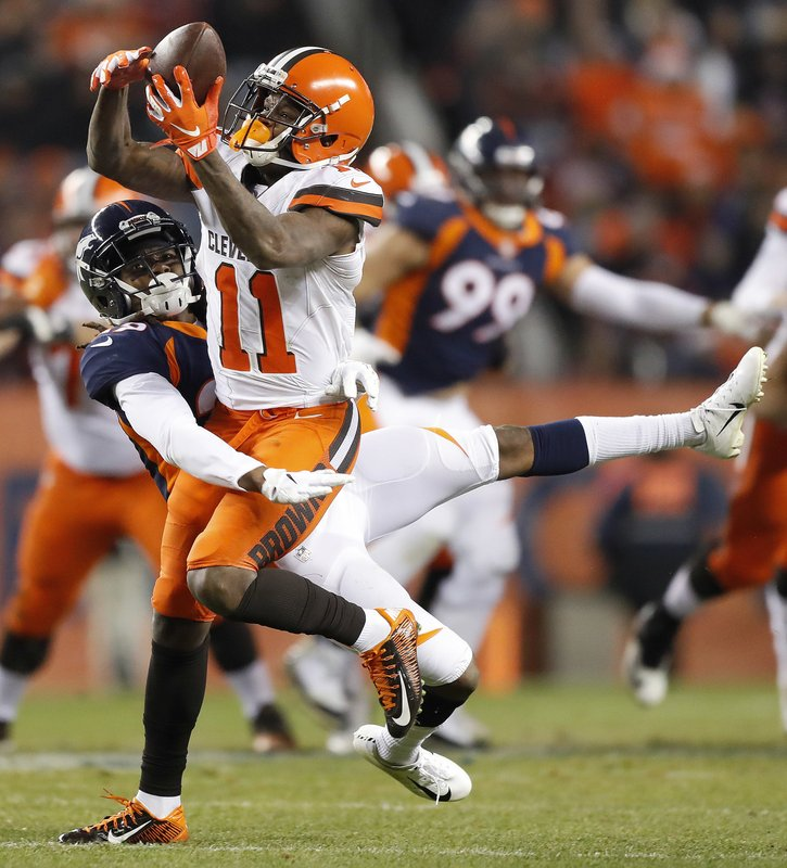 Cleveland Browns wide receiver Antonio Callaway (11) makes a catch as Denver Broncos cornerback Bradley Roby defends during the second half of an NFL football game, Saturday, Dec. (AP Photo/Jack Dempsey)