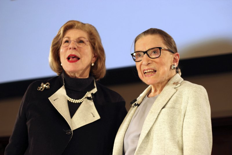 NPR's Nina Totenberg, left, and U.S. Supreme Court Justice Ruth Bader Ginsburg stand onstage at the New York Academy of Medicine after doing a question and answer session as part of the Museum of the City of New York's David Berg Distinguished Speakers Series, Saturday, Dec. (AP Photo/Rebecca Gibian)