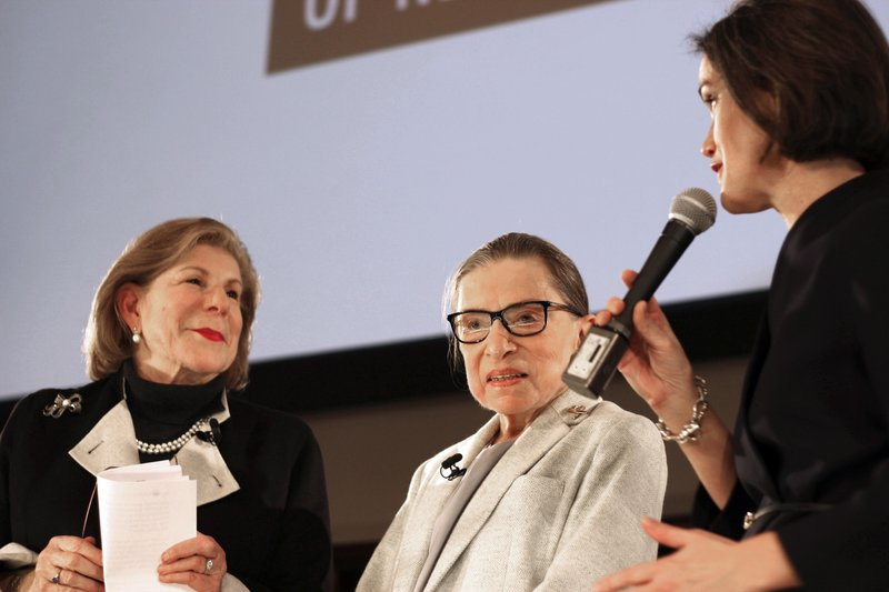 NPR's Nina Totenberg, left, and U.S. Supreme Court Justice Ruth Bader Ginsburg are thanked by Whitney W. (AP Photo/Rebecca Gibian)