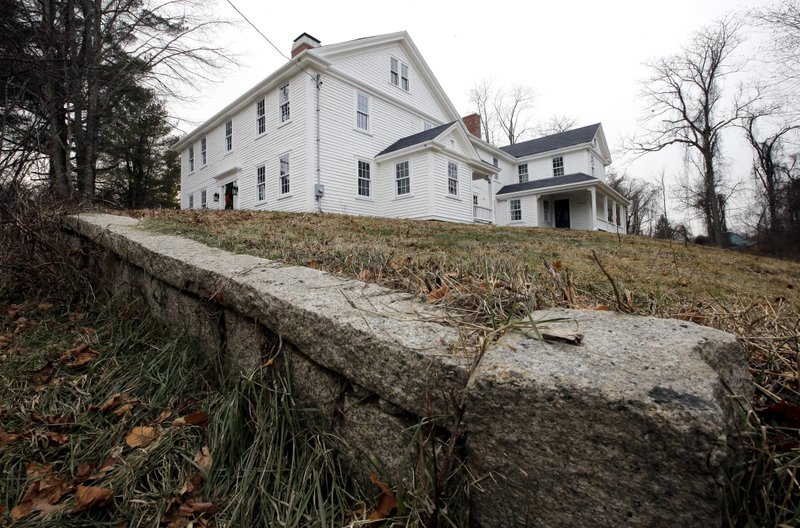 In this Thursday, Dec. 13, 2018 photo a wall stands near the home where Sarah Clayes lived, in Framingham, Mass. (AP Photo/Steven Senne)