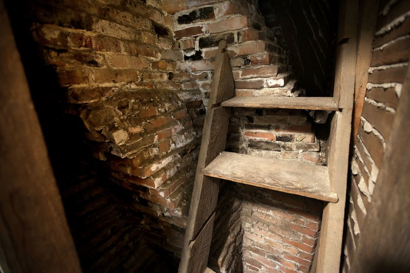 In this Thursday, Dec. 13, 2018 photo a set of steps rests against a twisting portion of a chimney at the home in Framingham, Mass. (AP Photo/Steven Senne)