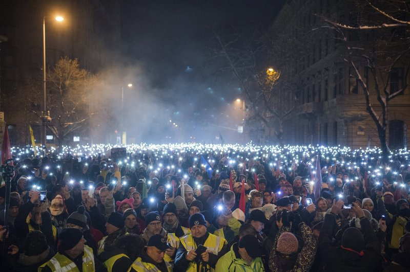 Anti-government demonstrators light up their mobile phones during their protest in the downtown of Budapest, Hungary, Sunday, Dec. (Zoltan Balogh/MTI via AP)