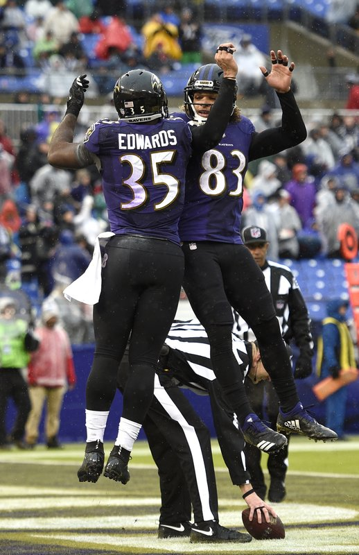 Baltimore Ravens running back Gus Edwards, left, celebrates his touchdown with teammate Willie Snead in the second half of an NFL football game against the Tampa Bay Buccaneers, Sunday, Dec. (AP Photo/Nick Wass)