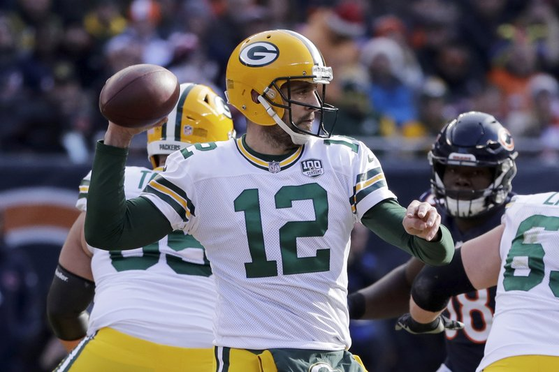Green Bay Packers quarterback Aaron Rodgers (12) throws a pass during the first half of an NFL football game against the Chicago Bears Sunday, Dec. (AP Photo/Nam Y. Huh)